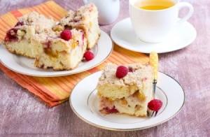 Slice of apple raspberry crumb cake on a white plate.