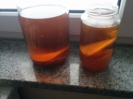 "Jars of vinegar with floating ""mothers""."