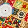 Beads and Buttons sorted in a wooden compartments