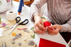 Woman crafting at her craft table