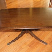 Value of a Mersman Coffee Table - plain top table with four legs from a central post