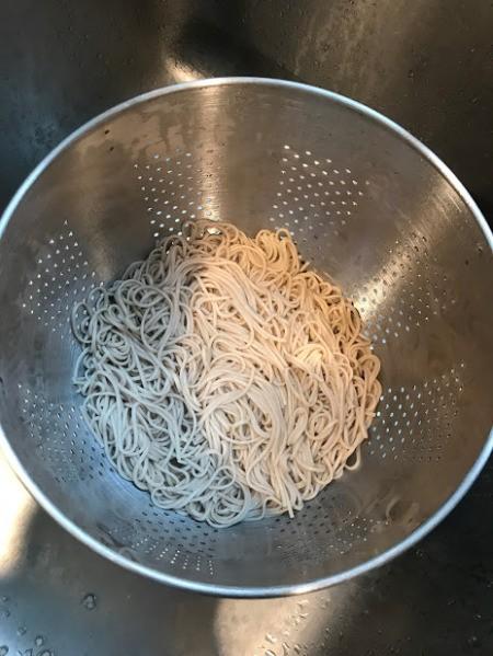 soba noodles in colander