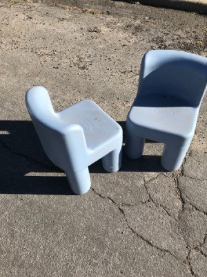 Two plastic children's chairs from an estate sale.