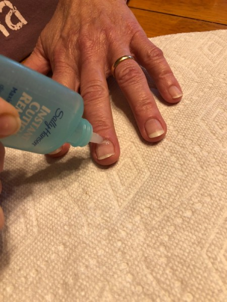 DIY Manicure - applying cuticle remover