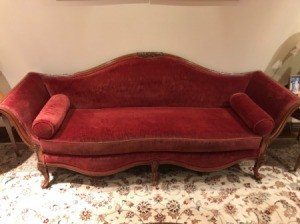 Value of a Vintage Davenport Couch - red vintage couch with scrolled back and front and bolster pillows as arms