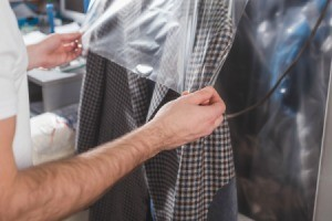 Coat being covered in a dry cleaning bag.