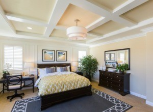Master bedroom with a yellow and grey color scheme.