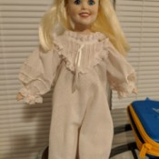 Identifying a Porcelain Doll - blond doll in one piece garment