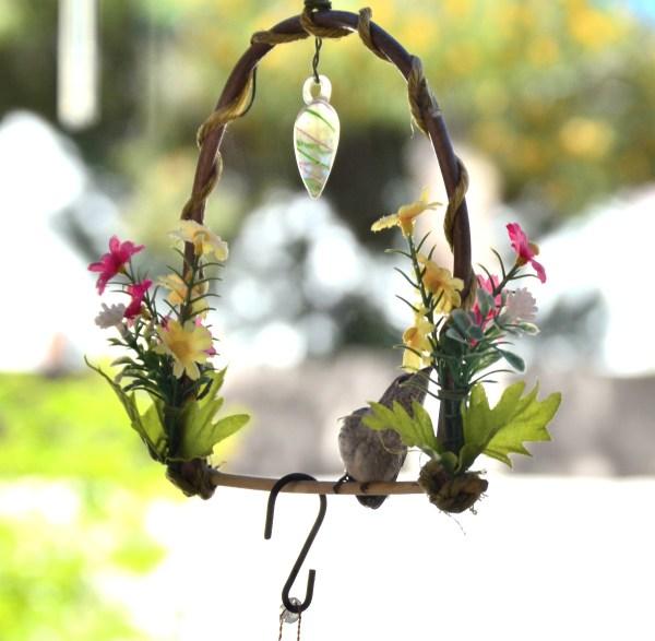 A brand new baby hummingbird on a perch.