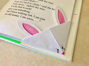 Folded Paper Bunny Corner Bookmark - closeup of bookmark on page corner