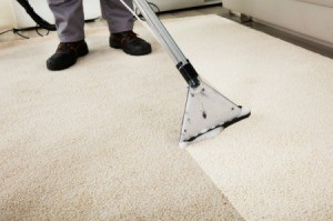 Carpet shampooer cleaning white carpet
