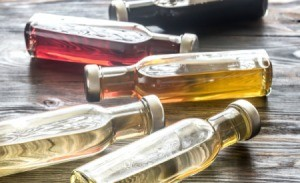 Assorted vinegars in glass bottles.