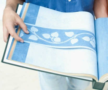 Wallpaper book with blue wallpaper.