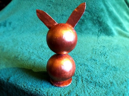 Styrofoam Ball Bunny Statue - finished bronze metallic bunny on turquoise background