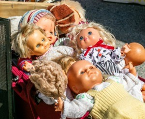 Pile of old baby dolls.
