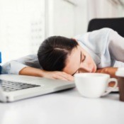 Woman sleeping at her work desk.