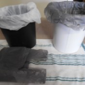 Plastic shopping bags used as wastebasket liners.