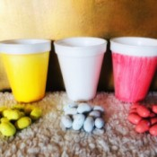 Painted Containers for Easter Egg Hunts - three painted containers and matching eggs