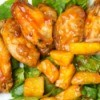 Baked pineapple chicken wings on a plate