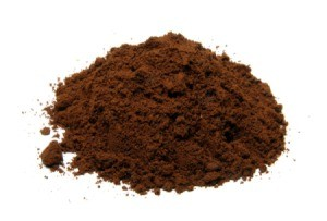 Pile of coffee grounds on a white background