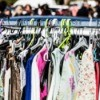 Used clothes on a rack being resold
