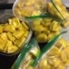 Sections of jackfruit in plastic bags and containers.