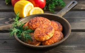 Salmon cakes in a cast iron pan.