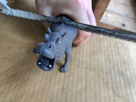 Making Plastic Animal Bookends - find midsection of animal and saw in half