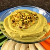 Pistachio Hummus on plate with cut vegetables