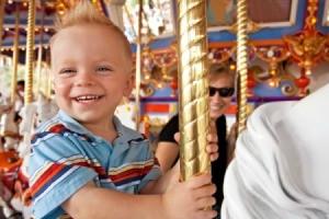Little boy on carousel