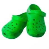 Green crocs on a white background