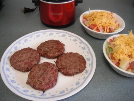 A plate of grilled hamburgers.