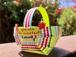 Craft Paper Basket - basket sitting outside on deck railing