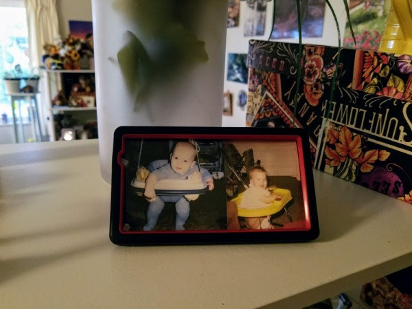 Old Phone Case as Photo Frame - case reassembled with baby photos