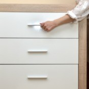 Woman trying to open a drawer.
