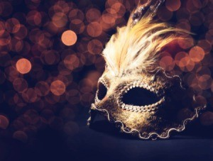 Masquerade mask on a black table.
