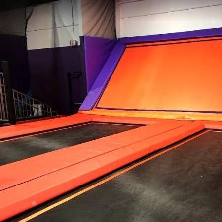 A trampoline playspace with no people.