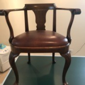 Value and Information on Antique Chairs - front view of low back chair with offset legs