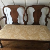 Identifying an Ornate Wooden Double Bench - dark wood two seat with upholstered seat