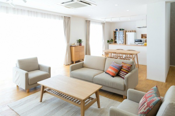 Beige Sofa Set With Wood Accents.