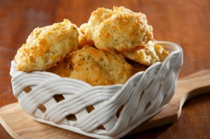Garlic cheese biscuits in a white ceramic basket.