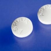 Close-up of aspirin pills on blue background