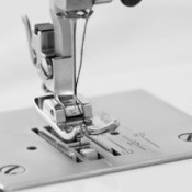Close-up of sewing machine needle