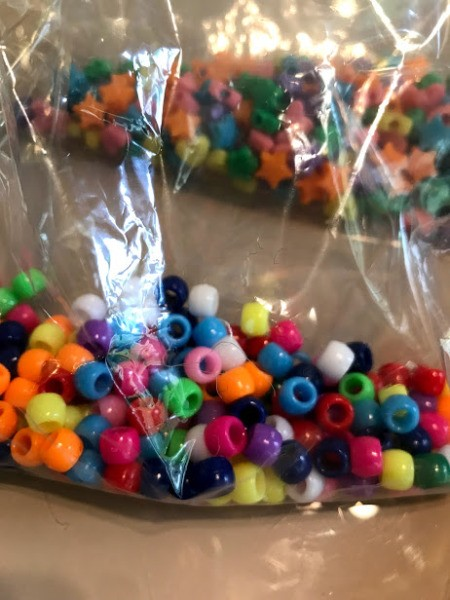 Pipe Cleaner Snake Toddler Craft - two bags of plastic beads