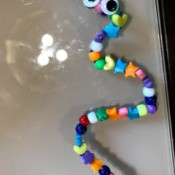 Pipe Cleaner Snake Toddler Craft - finished snake with google eyes