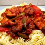Chicken Breast Cacciatore over pasta on plate