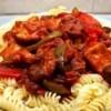 Chicken Breast Cacciatore over pasta on plate