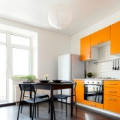Bright kitchen with orange cabinets.