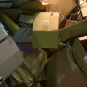 Closeup of used cardboard boxes piled up.