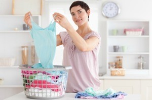 Woman folding freshly washed clothes